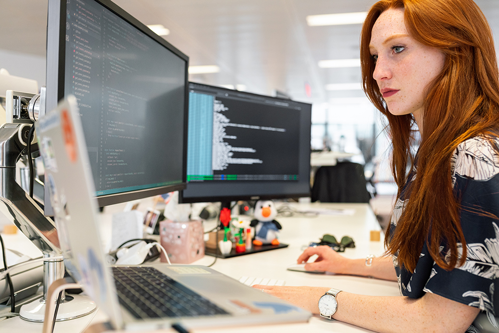 Woman on computer using SaaS in manufacturing